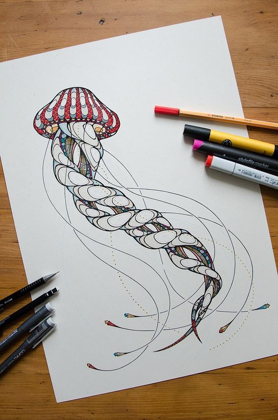 Nice colorful jellyfish with involuted tentacles tattoo design