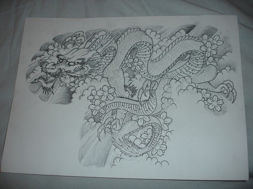 Nice mad uncolored dragon rushing under cherry blossom tattoo design
