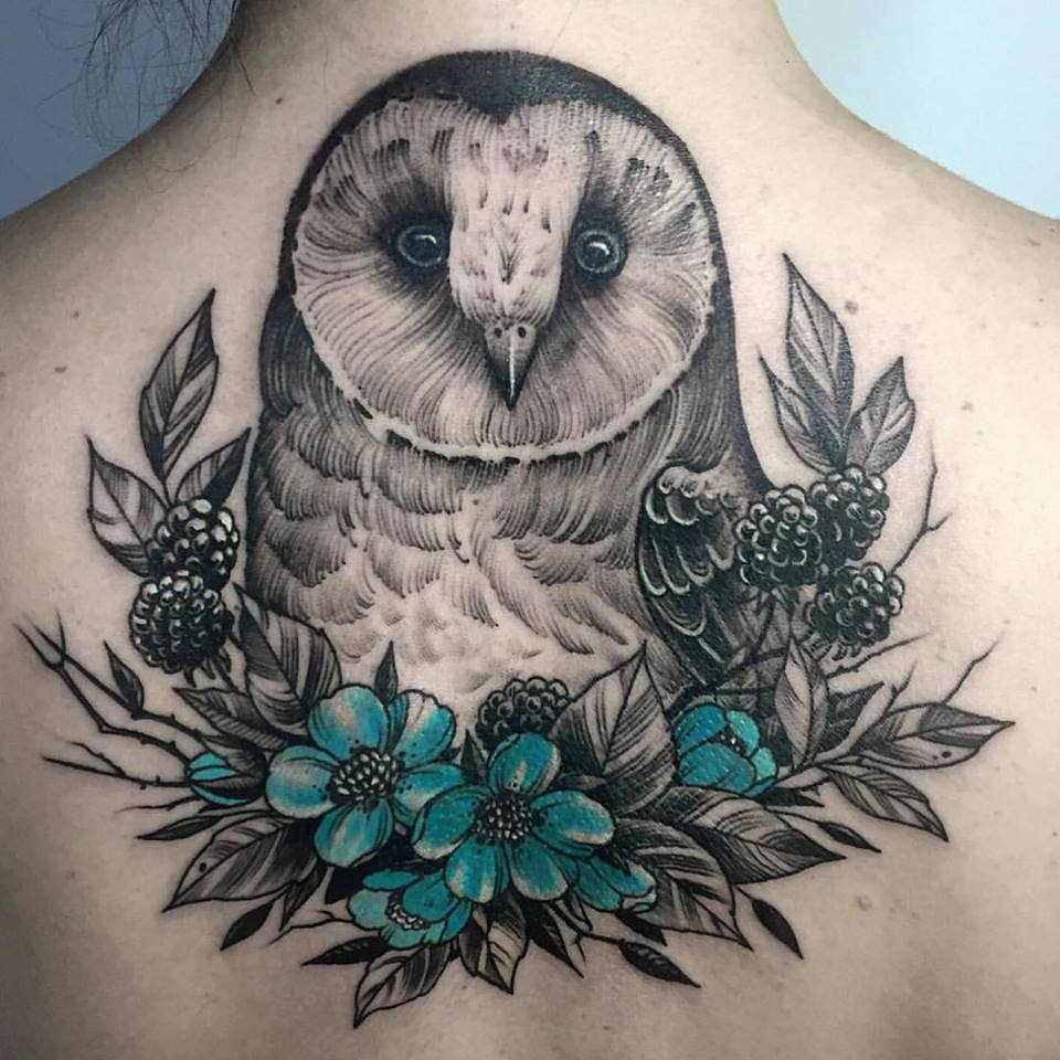 Nice owl and flowers tattoo on upper back
