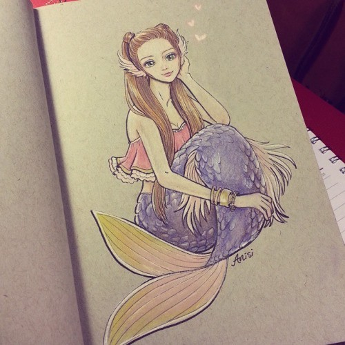 Nice purple-tail sitting mermaid with cute flipper-ears tattoo design