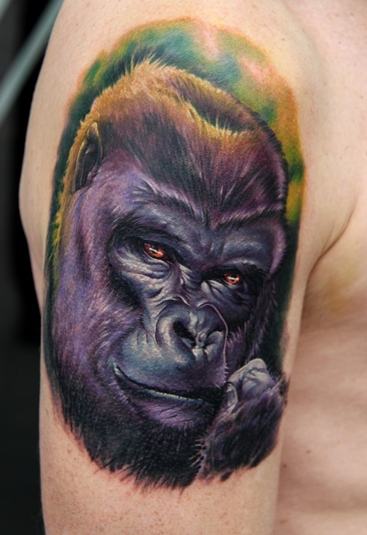 Nice realistic colorful gorilla muzzle tattoo on upper arm