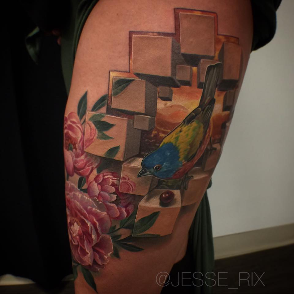 Nice tattoo with bird and 3d cubs