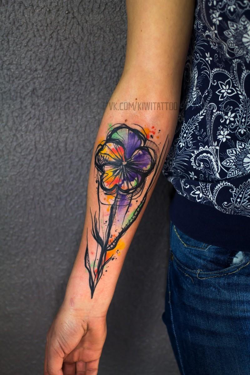 Nice watercolor flower tattoo on wrist