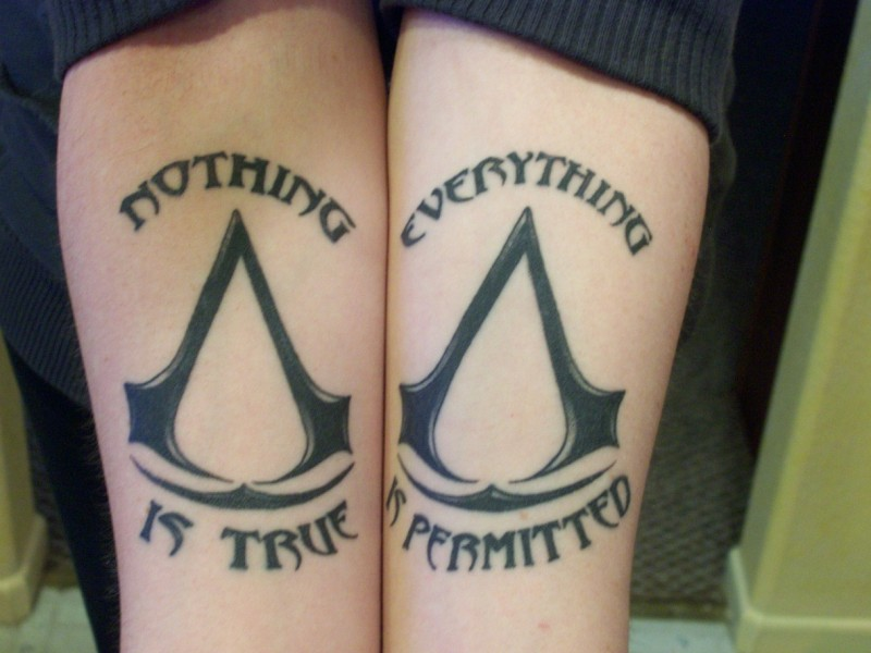 Nothing is true, everything is permitted quote with signs tattoo on both arms