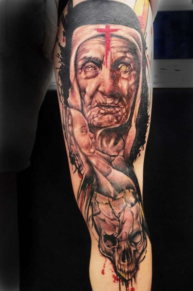 Old art like colored upper arm tattoo of old woman with little child