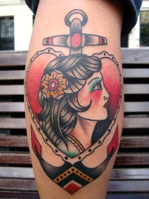 Old school anchor with girl in heart tattoo on shin