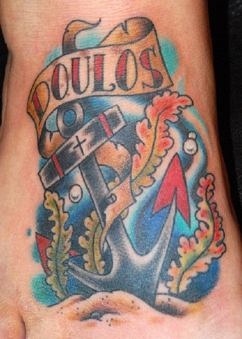 Old school anchor with lettering on see bottom tattoo on foot