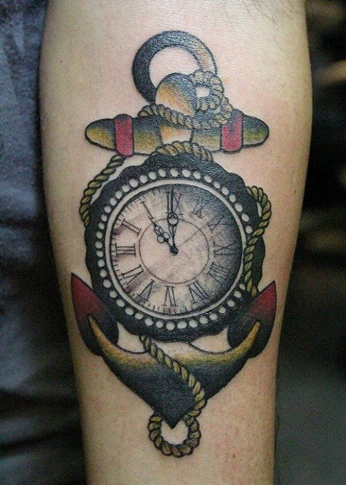 Old school anchor with watch tattoo on forearm