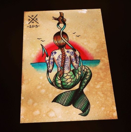 Old school colored mermaid from back sitting on a huge hook tattoo design