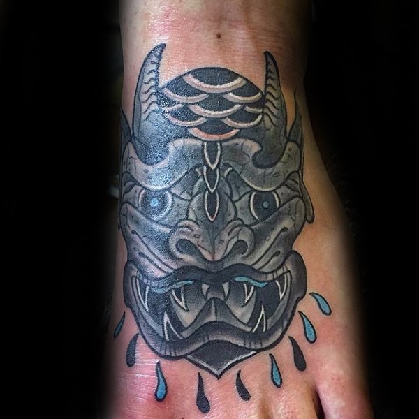 Old school colored style medium size gargoyle head tattoo on foot