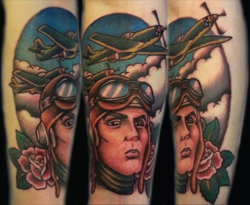 Old school style colored pilot portrait tattoo stylized with plaes and roses