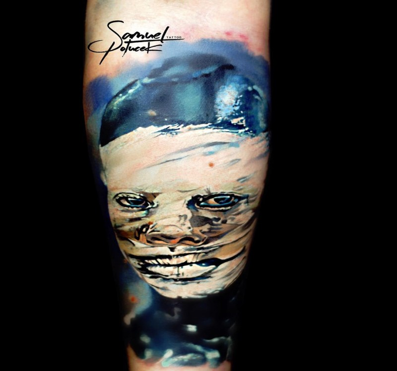 Old school style colored upper arm tattoo of monster portrait