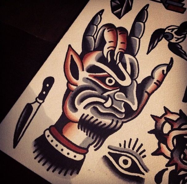 Old school style devil face print on the palm tattoo design