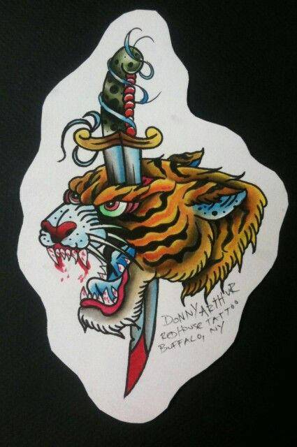 Old school tiger head killed with long dagger tattoo design