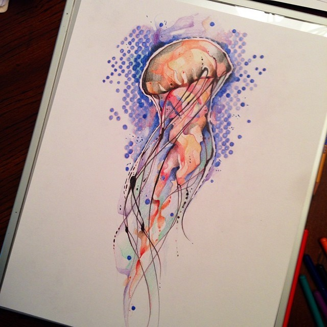 Orange watercolor jellyfish on blue circled background tattoo design