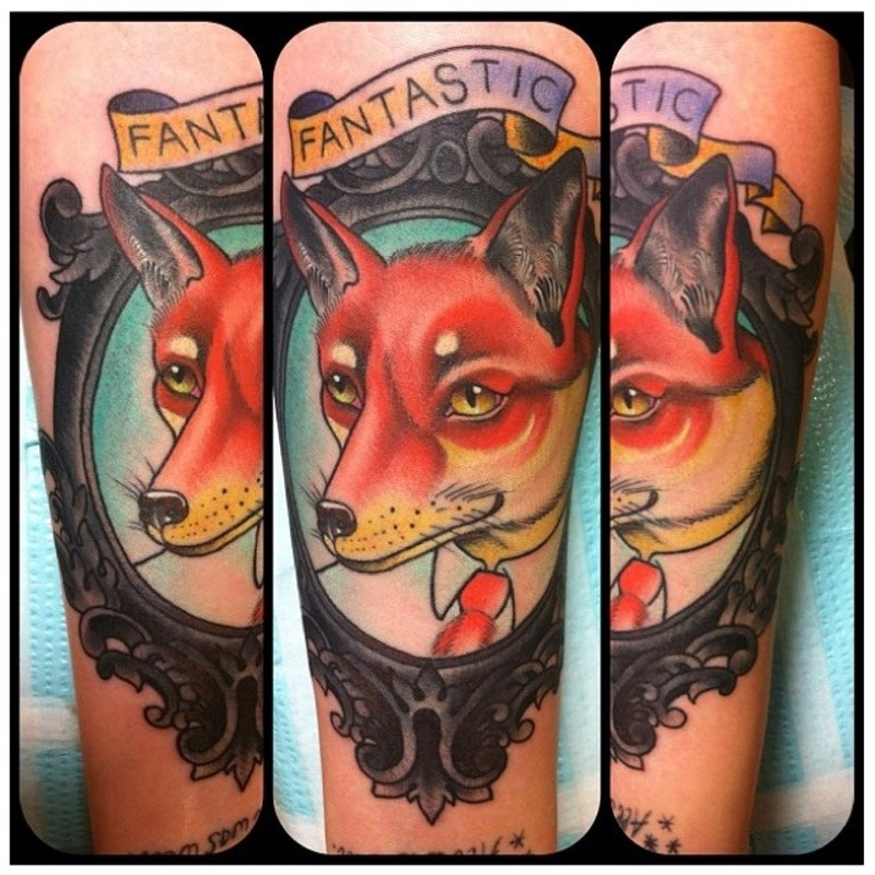 Original style painted and colored little fox portrait with lettering animal tattoo on arm