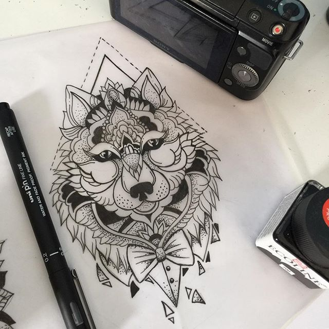 Ornamented wolf in tie-bow tattoo design