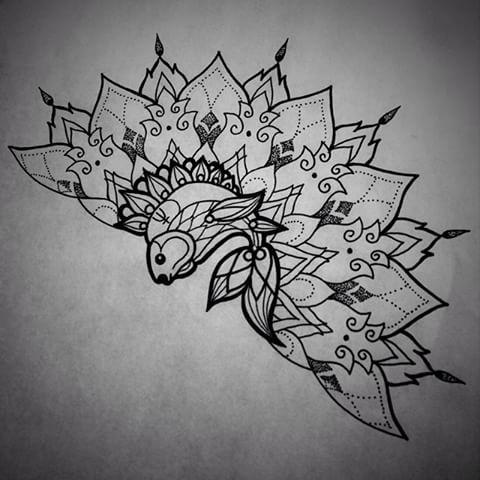 Ornate-fined fish and half-mandala tattoo design - Tattooimages.biz