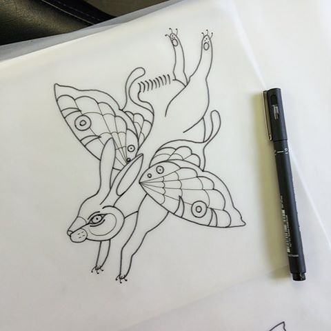 Outline running hare with butterfly wings tattoo design