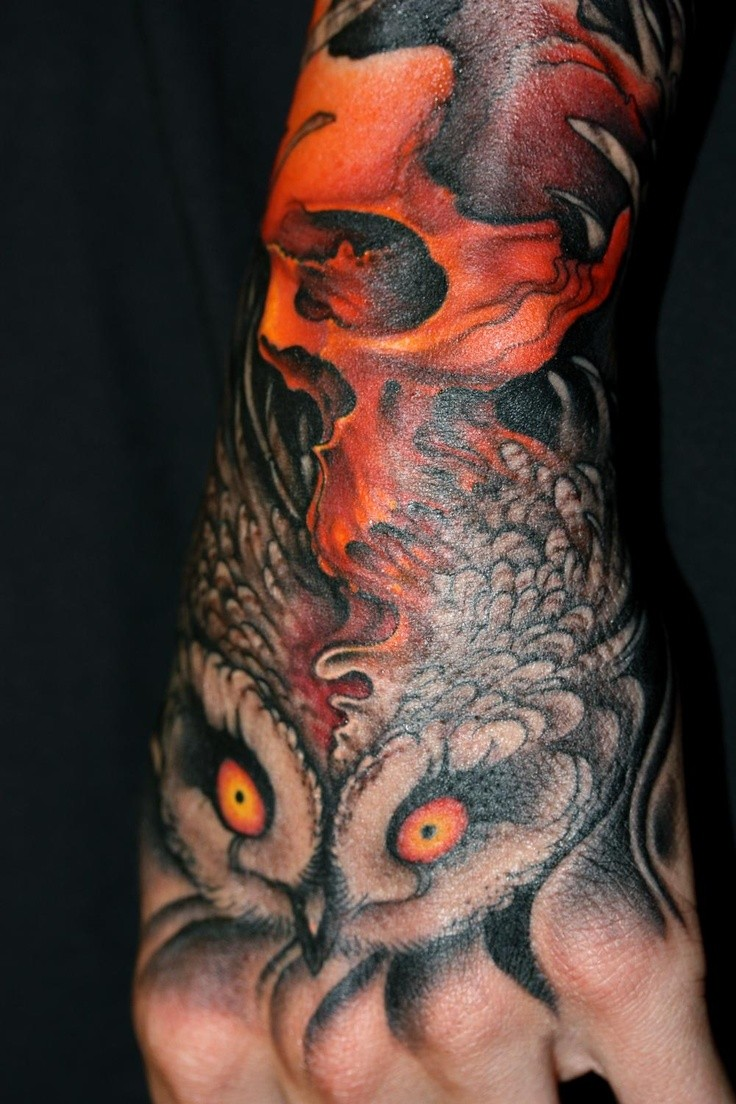 Owl with red skull wrist tattoo