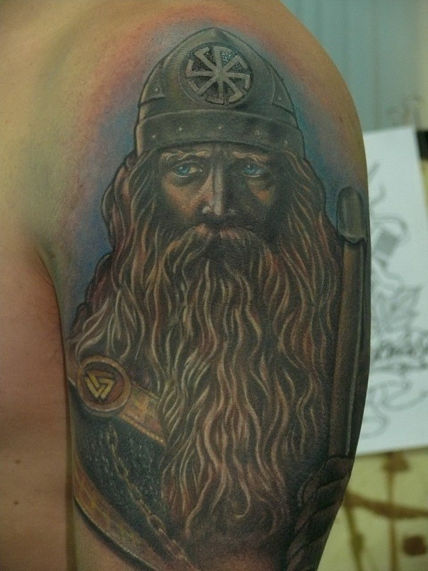 Pacified blue-eyed Viking tattoo on shoulder