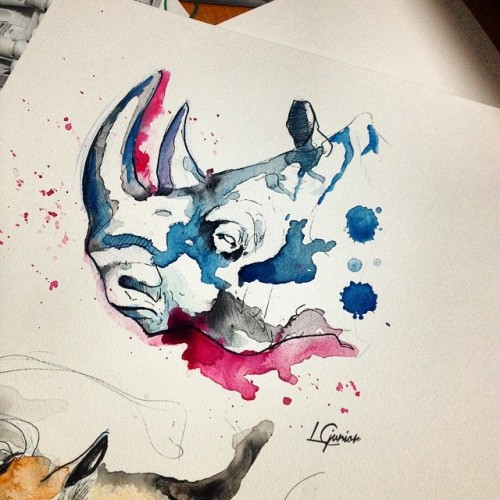 Pink-and-blue watercolor rhino head tattoo design