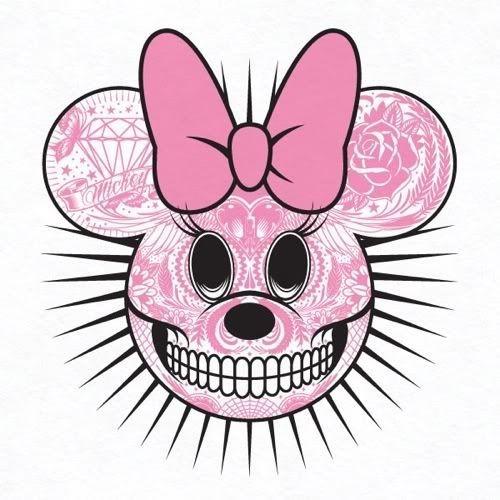 Pink-tattooed Minnie Mouse skull with big bow tattoo design
