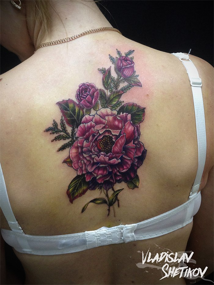 Pink flowers tattoo on upper back