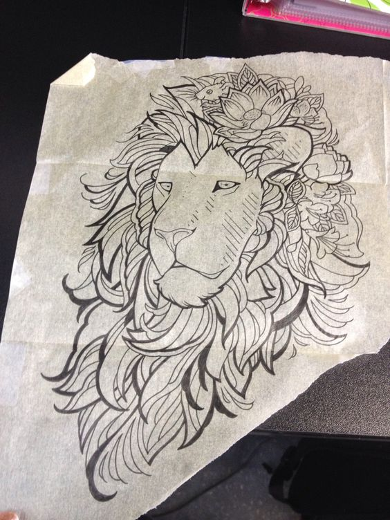 Pleased uncolored lion head decorated with flowers tattoo design