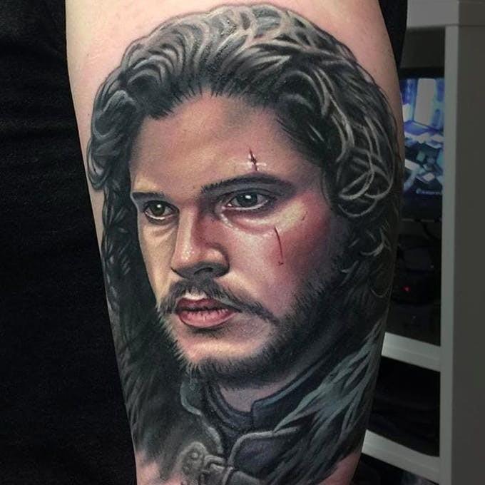 Portrait of John Snow tattoo on leg