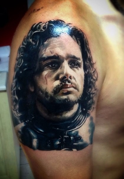 Portrait of John Snow tattoo on shoulder