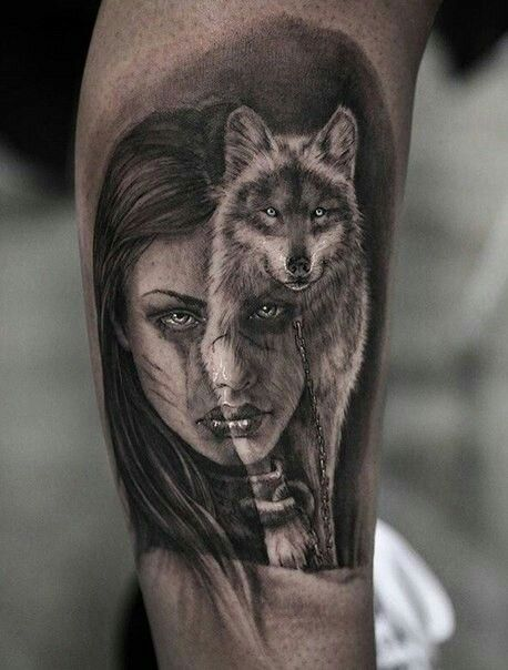 Portrait of girl with wolf tattoo on arm