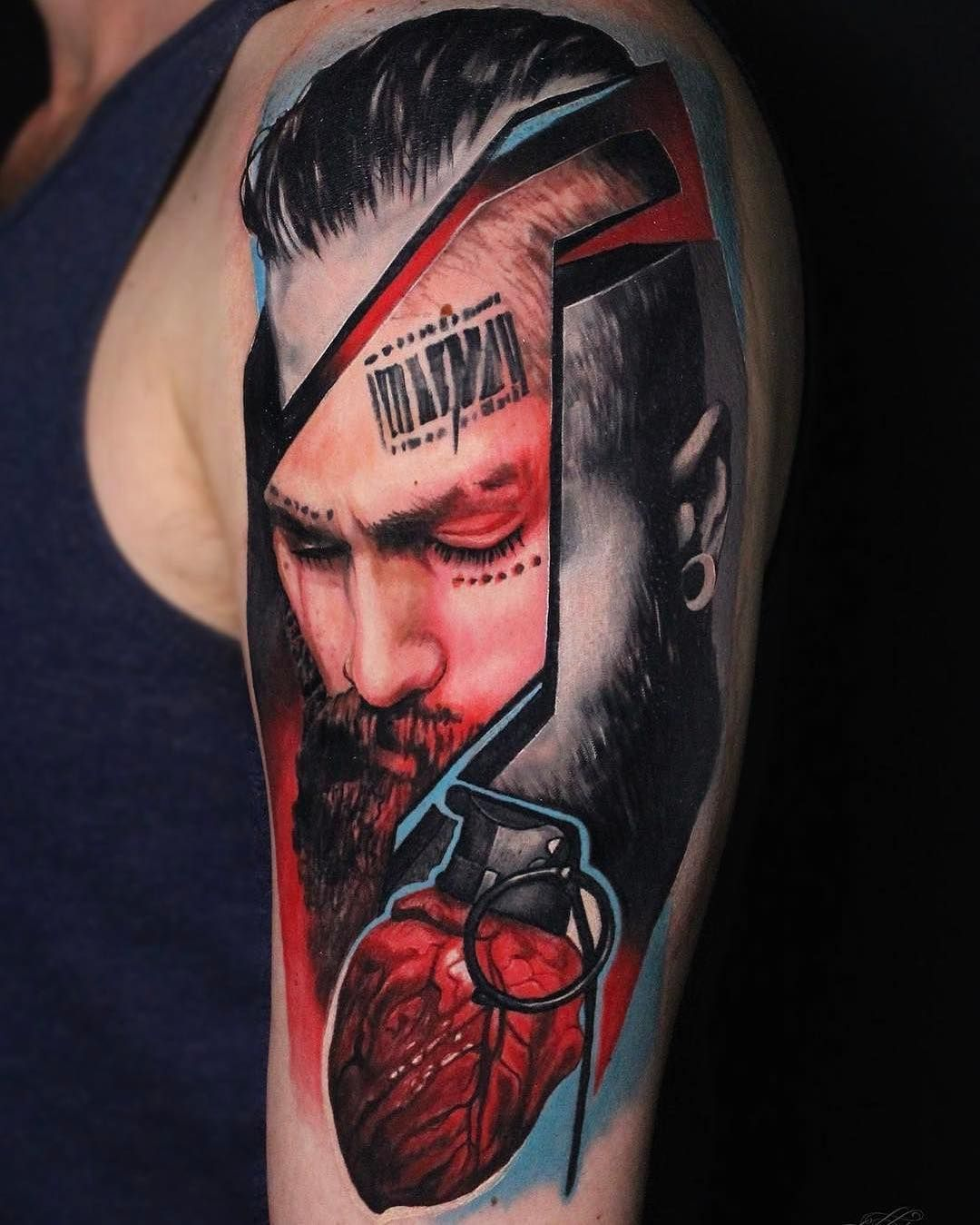 Portrait of man with heart tattoo by dave paulo