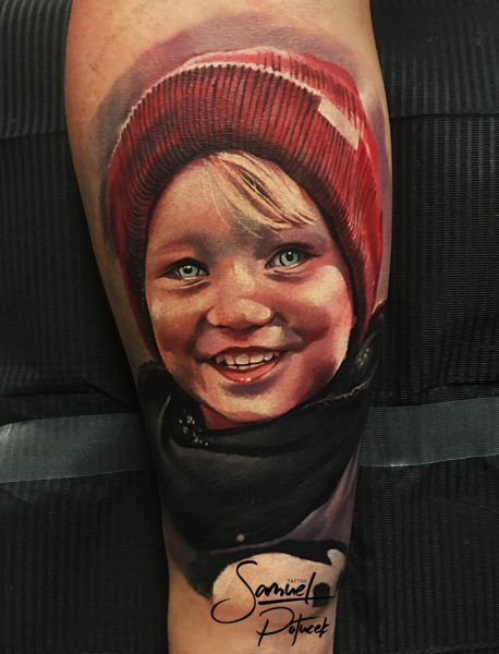 Portrait style colored tattoo of smiling boy