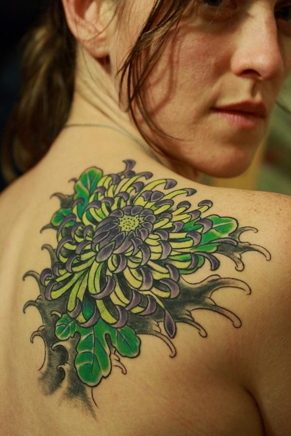 Pretty green flowers tattoo for women on back