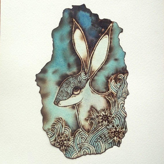 Printed hare on turquoise watercolor background tattoo design