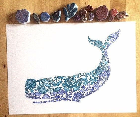 Purple-and-blue floral whale tattoo design
