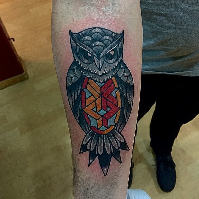 Quaint american classic tattoo with owl on arm