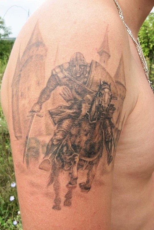 Racing warrior on horseback tattoo on shoulder