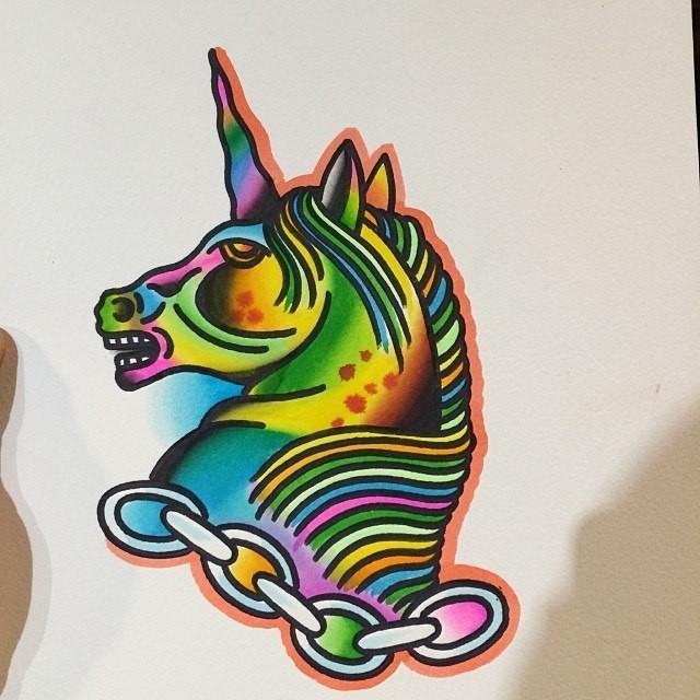 Rainbow-colored chained unicorn head in profile tattoo design