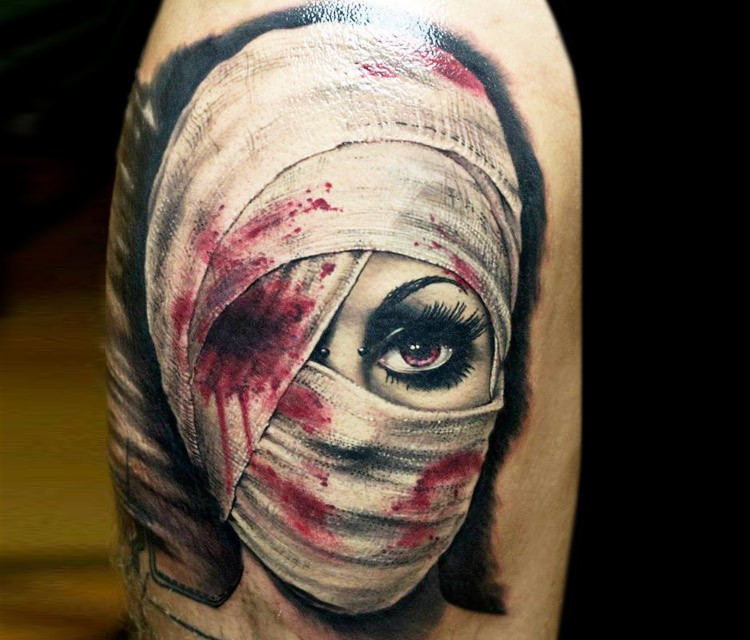 Reali Photo Like Colored Upper Arm Tattoo Of Bloody Woman