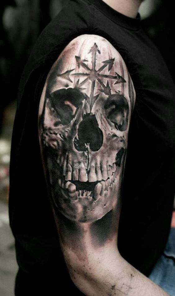 Realism style skull with sacred symbols tattoo by Neon Judas
