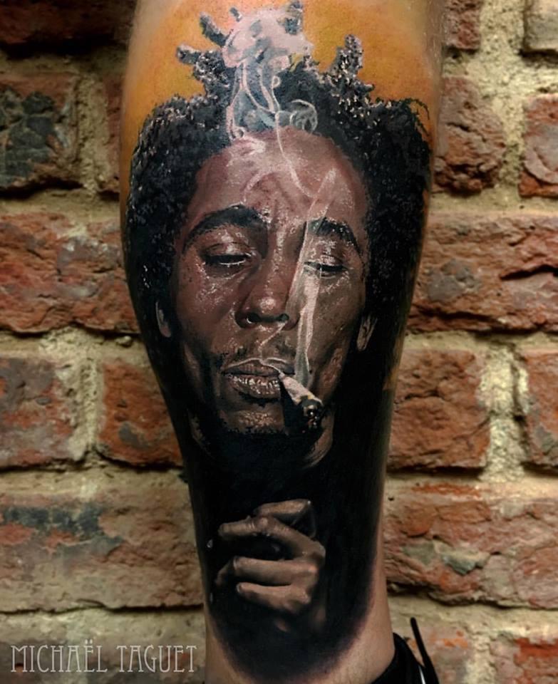 Realistic Bob Marley portrait tattoo