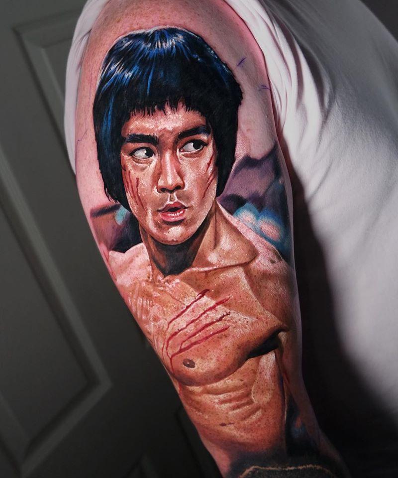 Realistic Bruce Lee tattoo on shoulder