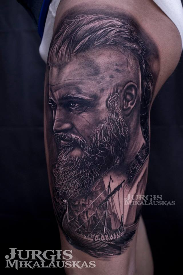Realistic Ragnar wikings tattoo on shoulder