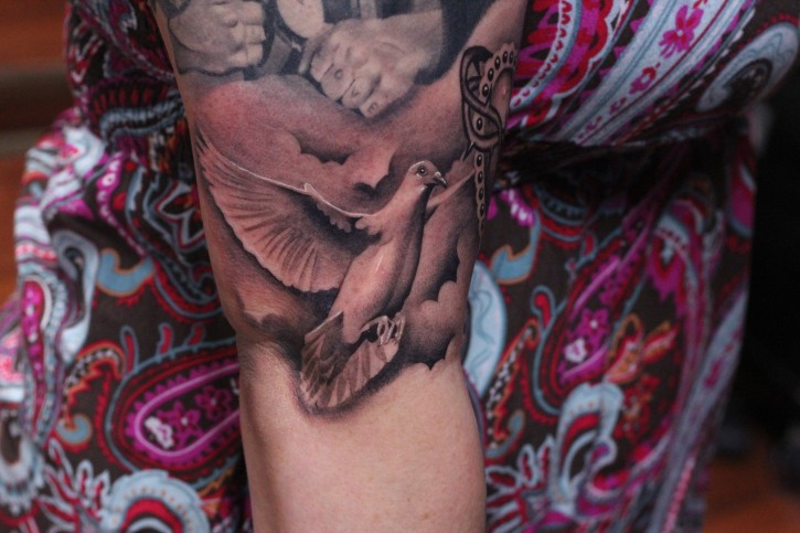 Realistic american classic flying dove tattoo on arm