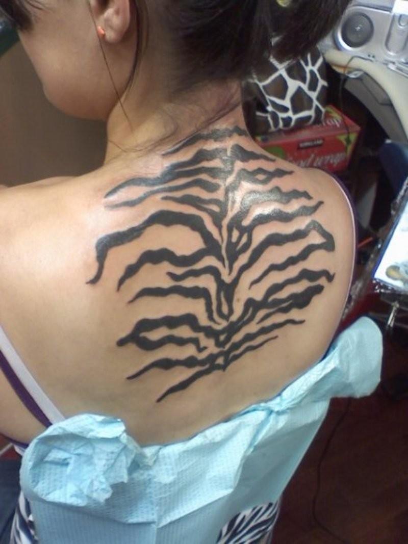 Realistic Black-ink Zebra Print Tattoo On Upper Back
