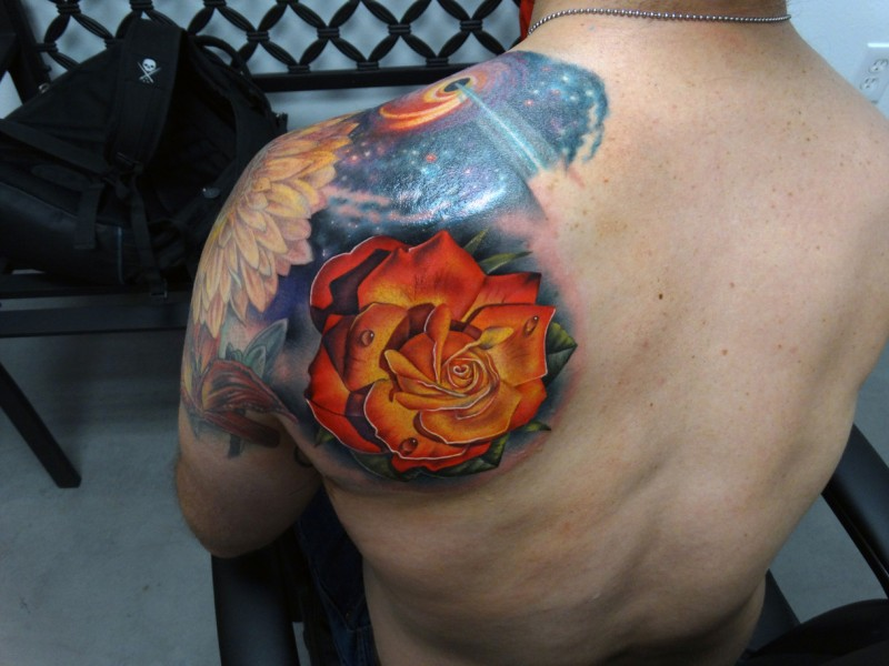 Realistic bright rose tattoo on shoulder