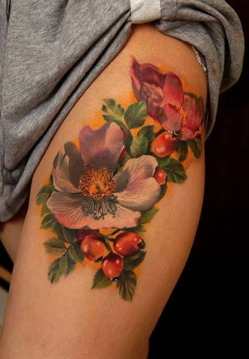 Realistic colorful flowers tattoo on thigh