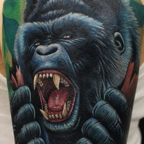 Realistic furious black gorilla tattoo on arm